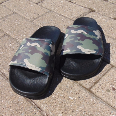 Slydes Caye Camo Slides with black soles.